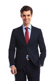 Smiling young business man in suit and tie standing. On white studio background Stock Photo
