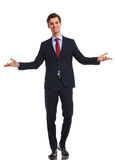 Smiling young business man in suit and tie welcoming you. On white studio background Stock Photos