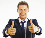 Smiling young business man thumbs up Royalty Free Stock Photography