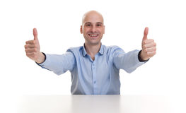 Smiling young business man thumbs up. Isolated over white stock photography