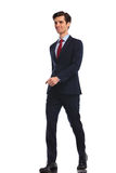 Smiling young business man walking forward. Full body picture of a happy smiling young business man walking forward , isolated on white background Royalty Free Stock Photo