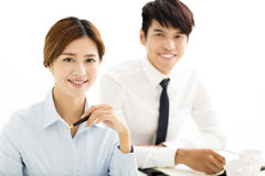 Smiling young business man and woman  in office Stock Photo