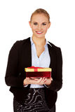 Smiling young business womamn holding present box Stock Image