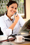 Smiling young business woman. Smiling young Indian business woman talking on phone Royalty Free Stock Photography