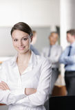 Smiling young business woman Stock Photo