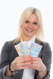 Smiling young business woman with euros Stock Image