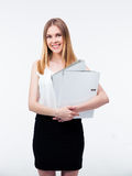 Smiling young business woman holding folders Stock Photo