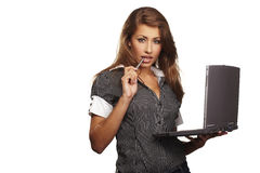 Smiling young business-woman holding pen Stock Photo