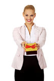 Smiling young business woman holding present box Royalty Free Stock Photo