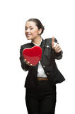 Smiling young business woman holding red heart Royalty Free Stock Photos