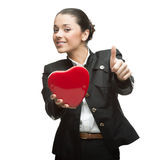 Smiling young business woman holding red heart Royalty Free Stock Photography