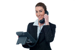 Smiling young business woman on phone Stock Photo