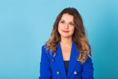 Smiling young business woman portrait on blue background. Smiling young business woman portrait on blue background Royalty Free Stock Photos