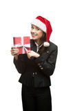 Smiling young business woman in santa hat holding Royalty Free Stock Photo