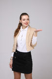 Smiling young business woman showing blank area Royalty Free Stock Image