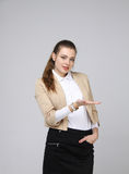 Smiling young business woman showing blank area Royalty Free Stock Photo