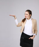 Smiling young business woman showing blank area Royalty Free Stock Photography