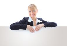 Smiling young business woman showing blank sign Royalty Free Stock Photography
