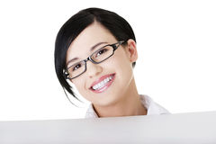 Smiling young business woman showing blank signboard Stock Image