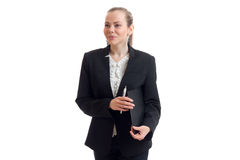 Smiling young business woman stands upright in the jacket and holding a folder. Isolated on white background Royalty Free Stock Images