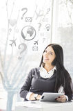 Smiling young business woman with tablet PC at her office and signs Royalty Free Stock Images