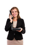 Smiling young business woman talking on phone. Portrait of smiling young business woman talking on phone isolated on white Royalty Free Stock Photos