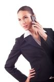 Smiling young business woman talking on the phone (isolated on w Royalty Free Stock Photos