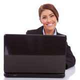 Smiling young business woman using laptop Stock Photo