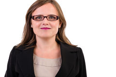 Smiling young business woman wearing glasses. Portrait of a smiling young business woman wearing  glasses on white Stock Photos