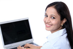 Smiling young business woman working with laptop Royalty Free Stock Image