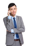 Smiling young businessman answering phone Stock Images