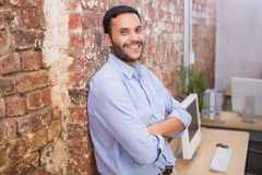 Smiling young businessman with arms crossed Stock Images