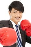 Smiling young businessman with boxing gloves Royalty Free Stock Photos