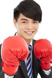 Smiling young businessman with boxing gloves Royalty Free Stock Images