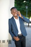 Smiling young businessman calling by cell phone Royalty Free Stock Images