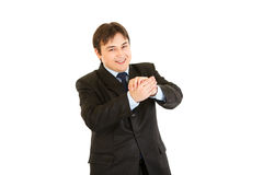 Smiling young businessman cheerfully applauding. Isolated on white Stock Photography