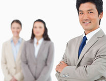Smiling young businessman with colleagues behind him Royalty Free Stock Photo