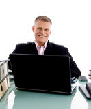 Smiling young businessman at desk working Stock Photography