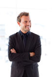 Smiling young businessman with folded arms Stock Images