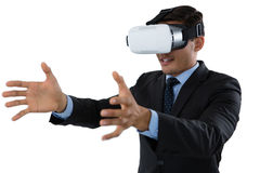Smiling young businessman gesturing while using vr glasses Stock Image