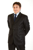 Smiling young businessman with hands behind back Royalty Free Stock Photos