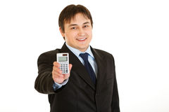 Smiling young businessman holding calculator Royalty Free Stock Image