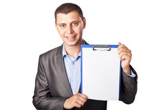 Smiling young businessman holding clipboard Royalty Free Stock Image