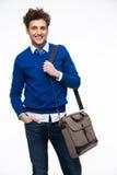 Smiling young businessman with laptop bag Stock Photos