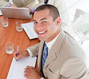 Smiling young businessman in a meeting Royalty Free Stock Image