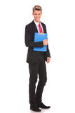 Smiling young businessman with a notepad Royalty Free Stock Photos