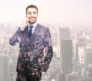 Smiling young businessman over city background Royalty Free Stock Photography