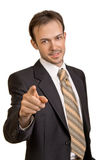 Smiling young businessman  points to camera Royalty Free Stock Photos