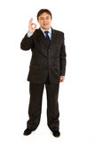 Smiling young businessman showing ok gesture Royalty Free Stock Images