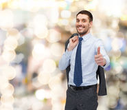 Smiling young businessman showing thumbs up Stock Photos